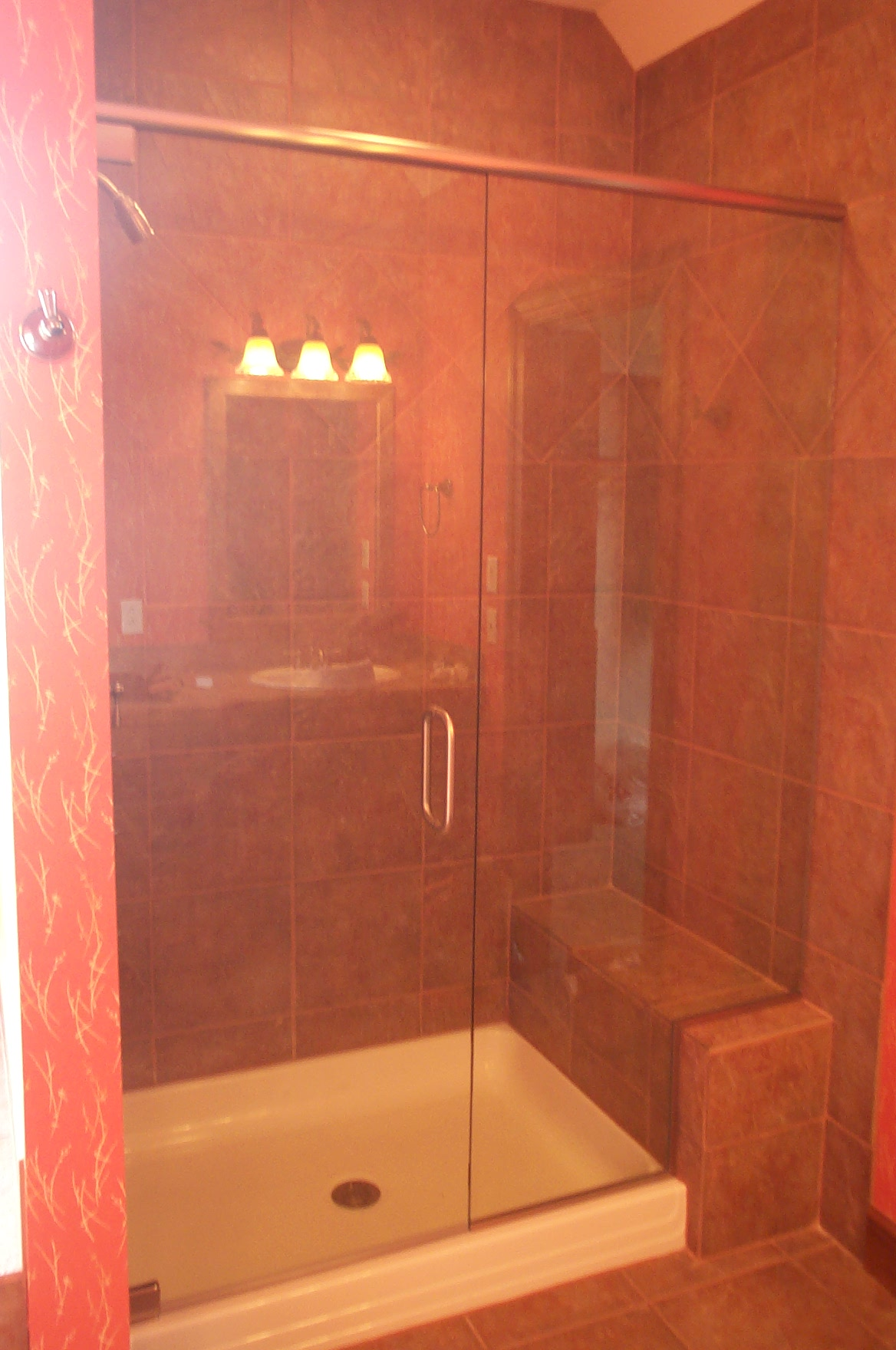 Frame-less Glass shower door with Chrome Hardware