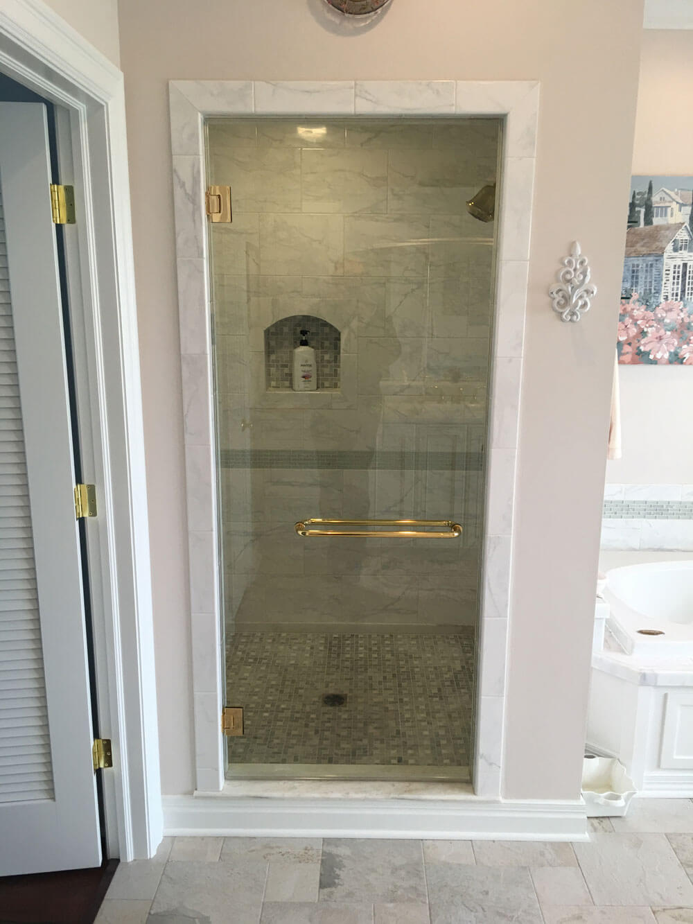 Glass Shower Door with Gold Hardware